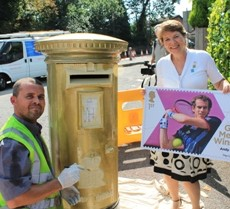 Diana Sterck, CEO of Merton Chamber with Andy Murrays stamp and gold post box.